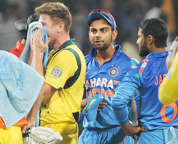Virat Kohli responds to James Faulkner during the 2013 series