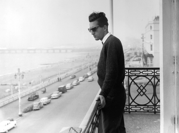 Tiger Pataudi stands in the balcony of a hotel