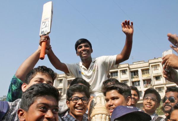 Pranav Dhanawade celebrates his 1009