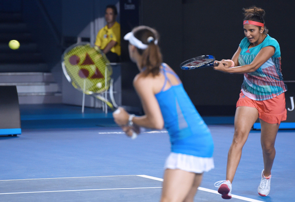Sania playing a shot from the baseline