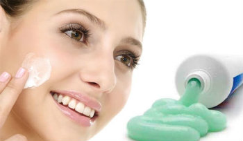 Applying toothpaste on face