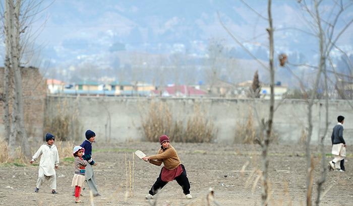 Kid Playing Cricket