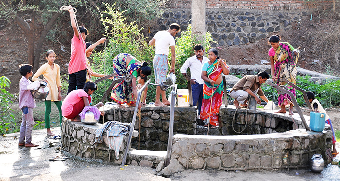People at well