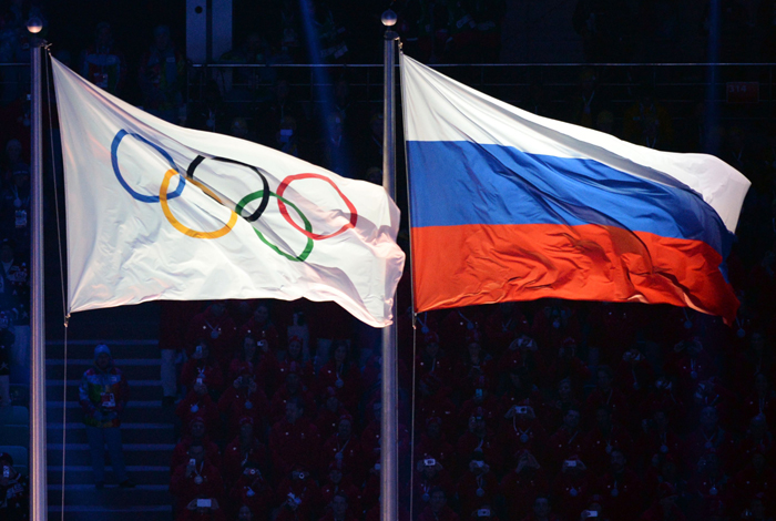 Olympics flag (left) and Russian flag