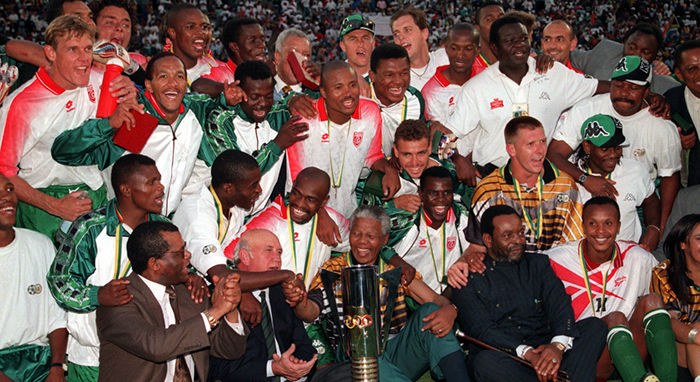 Nelson Mandela celebrating the Africa cup win with the football team in 1996