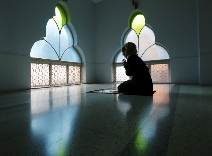 Woman Prays At A Mosque