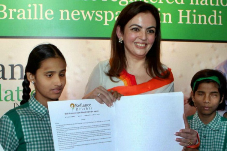 The Braille newspaper launch photograph appearing here is from the function organized by Reliance Foundation on March 19, 2012