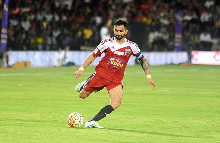 Virat Kohli kicks the ball