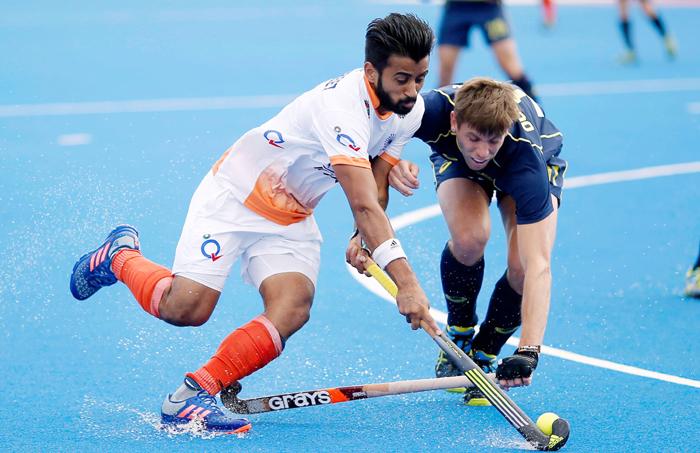 Manpreet Singh vying for the ball