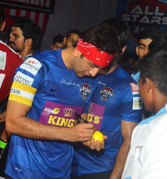 Ranbir signing an autograph
