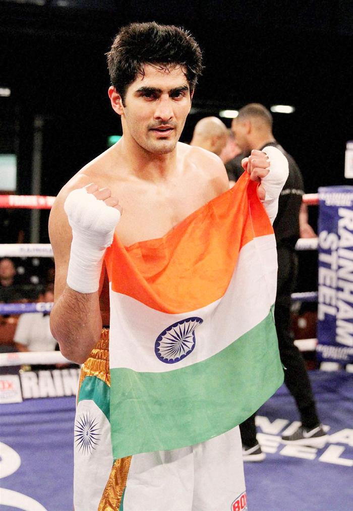Vijender with Indian flag