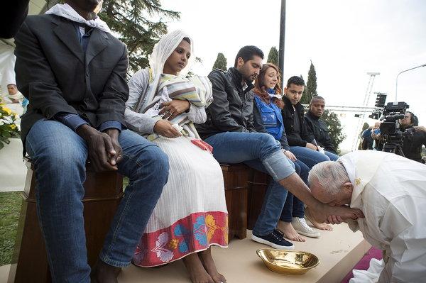 Pope touching feet