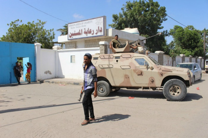Yemeni forces outside the elderly care home