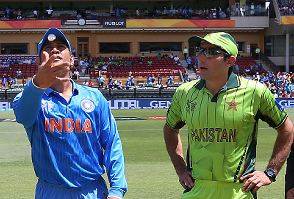 Dhoni spins the coin for the toss against Pakistan