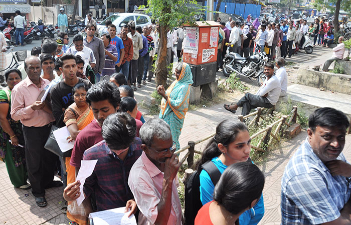 People Wait Out Side Bank