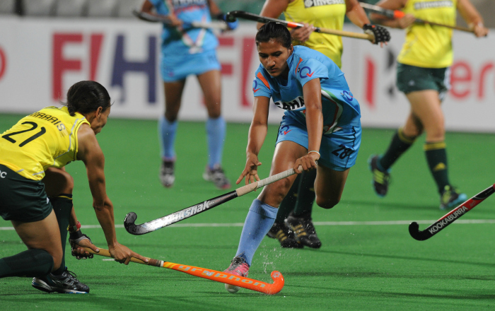Rani Rampal vies for the ball