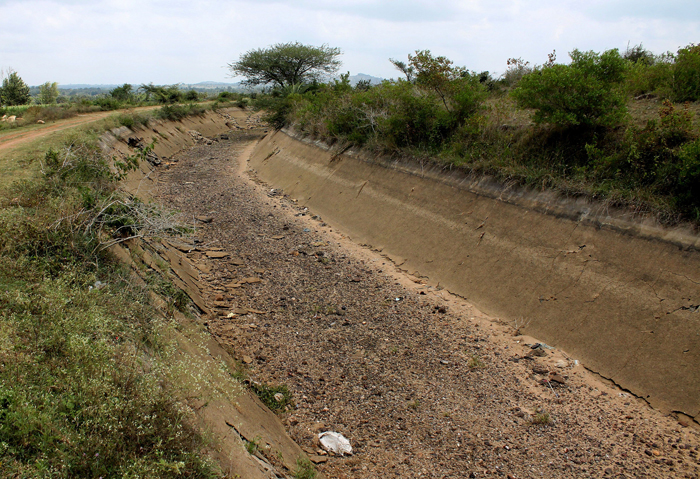 After waiting a quarter century farmers rebuild dam on their own