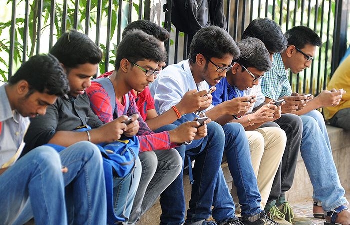 Youth Using Mobile Phone