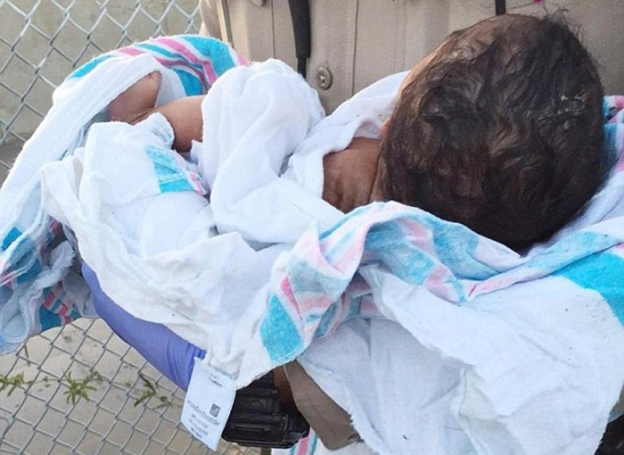 A four-day-old baby girl which was to be buried alive by a heartless man was rescued by an autorickshaw driver in Ballari dsitrict