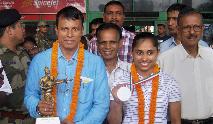 Bishweshwar Nandi and Dipa Karmakar