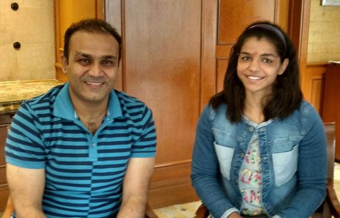 Virender Sehwag and Sakshi Malik