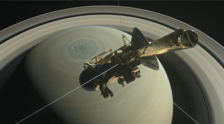 An illustration of NASA's Cassini spacecraft above Saturn