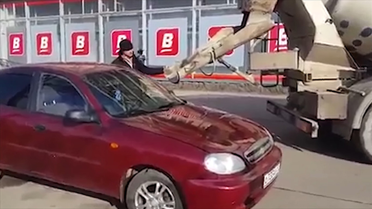 man fills car with concrete