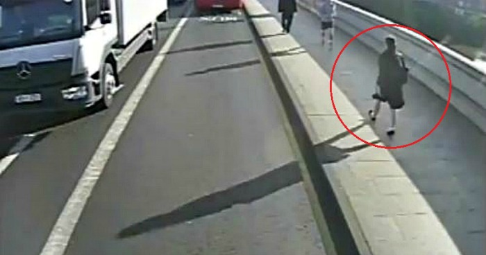 Male jogger pushes a woman in front of a moving bus