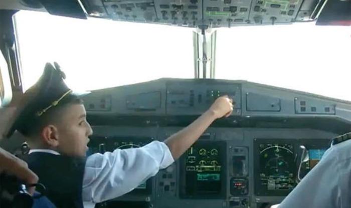 Boy flies plane