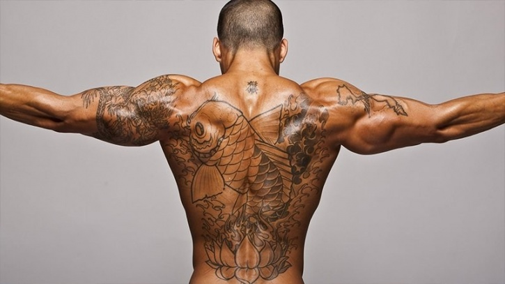 The good news is that this phenomenon applies mostly to people who get excessive tattooing done to their body; not people who get a single tattoo or even a few scattered ones, reports Time.  This is true especially for people who have an extensive coverage on their back, arms, or other areas that heavily covered with sweat glands. The tattoos can interfere with your skin's ability to cool your body and retain important nutrients.