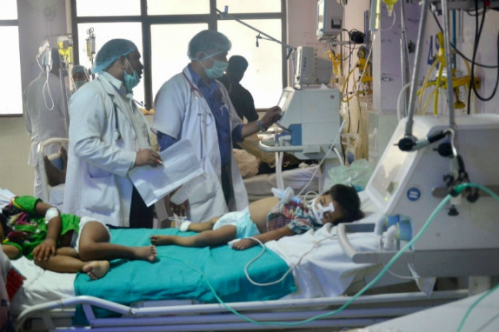 """According to the World Health Organisation (WHO) around a 100 pathogens can trigger AEC and around a three-dozen can be narrowed down to India, which make the diagnosis vague for AES, reported the Fountain Ink in a report. Although the Japanese Encephalitis virus is of the most common viruses it accounts for less than a quarter of all reported cases in India, which explains why the number of AES cases are significantly higher than reported number of JE cases, states the report.  61-year-old Ravi Vasanthapuram, a neurovirologist at NIMHANS calls AES a """"dustbin diagnosis""""; a label he uses to file every reported case of encephalitis for which you can't find an exact cause. """"For around 80 per cent of the patients who come here, we can't give a proper diagnosis,"""" says Mahima Mittal, head of the department of paediatrics at the Baba Raghav Das Hospital (BRD)."""