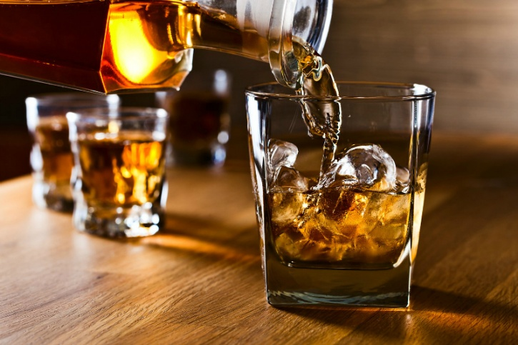 Researchers at the Linnaeus University in Sweden carried out a test to examine how compounds such as guaiacol in whiskey moved around with the presence of water in it.  Adding water to your drink frees guaiacol from its entrapments and enhances its smell and taste! The flavour in whiskey comes from the molecule called guaiacol, which is what gives whiskey its smoky, spicy and peaty flavour. It resembles other compounds such as vanillin (a compound that tastes like vanilla).