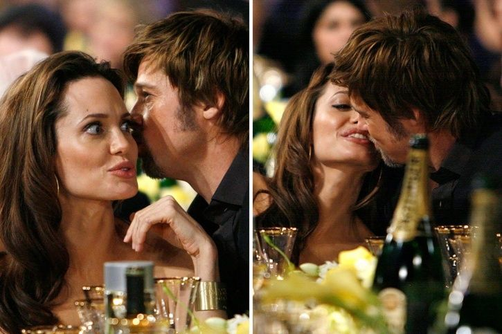 A still of Angelina Jolie and Brad Pitt kissing each other