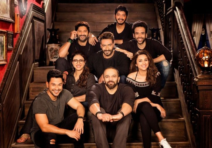 A still of Golmaal Again cast with director Rohit Shetty