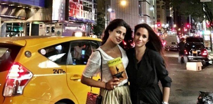 Priyanka Chopra strikes a pose with actress Meghan Markle.