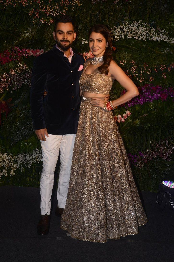 Virat Kohli and Anushka sharma full length picture from their wedding reception at Mumbai.