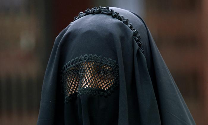 Placards identify burqa-clad