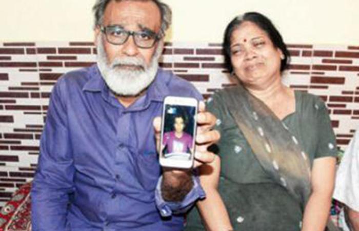 Rakesh Talreja's parents grieve at their Vasai home