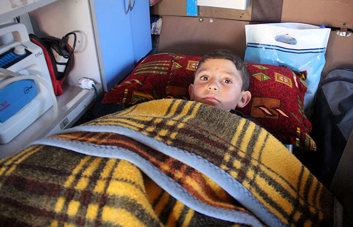 Syrian Boy Who Injured in Barrel Bomb Attack