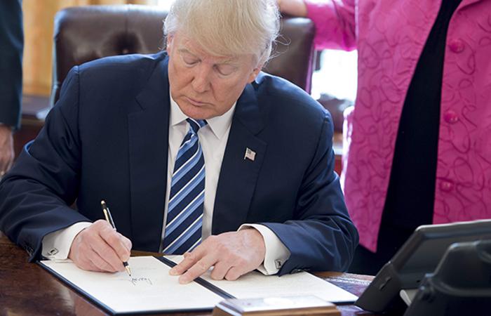 Donald Trump Signing Paper