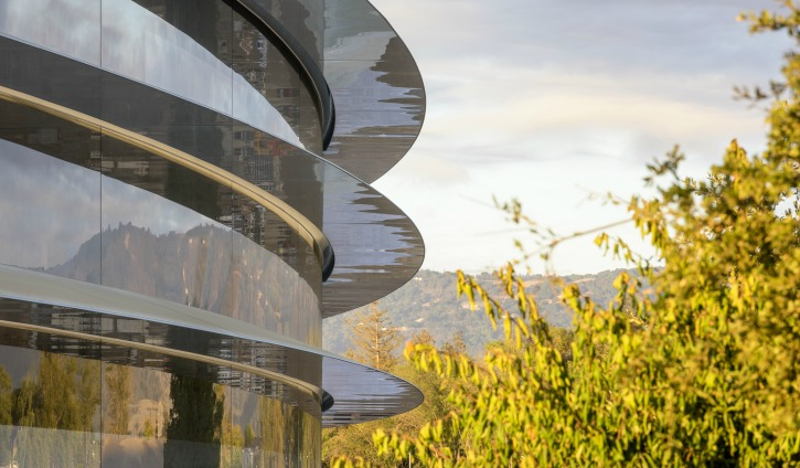 Apple main building which is clad entirely in the world's largest panels of curved glass
