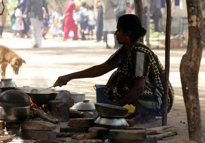 Village woman cooking