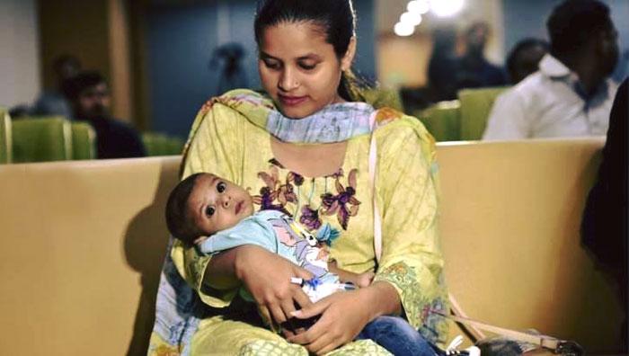 Pakistani couple Kanwal Siddiq and Anam
