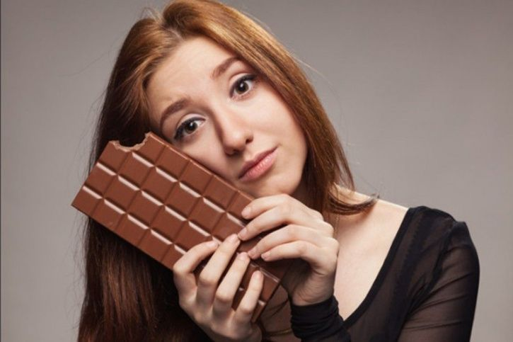 Just make sure that you eat the dark variety that has more than 70 percent cacao in it, which automatically reduces the content of milk, sugar and butter in it that makes the chocolate fatty. Also, try and restrict your consumption to around 200 grams or about four dark chocolate bars a week