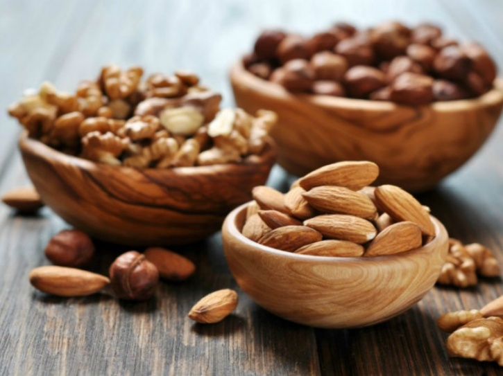 Nuts such as pecans and almonds are not only packed with protein and antioxidants, but also add a crunch to your salads and pulses while satiating you.