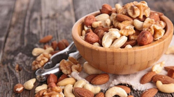 Walnuts contain the amino acid L-arginine, which is one of the primary building blocks of nitric oxide; a naturally occurring gas that helps men maintain their erections. Cashews on the other hand are loaded with zinc; an mineral that improves your testosterone production