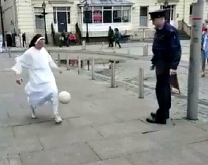 nun plays football with policeman