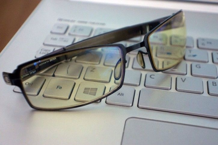 Wear anti-glare coated glasses to filter out harmful artificial light