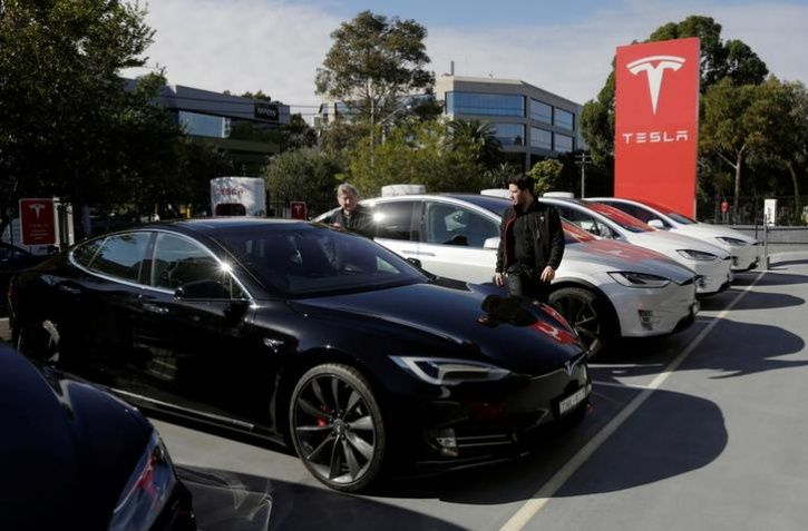 A Tesla Model S electric car is prepared for a test drive
