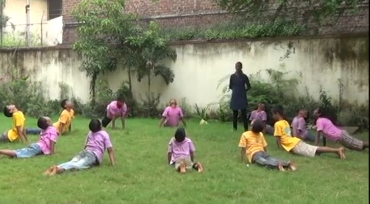 Kids exercising at the shelter